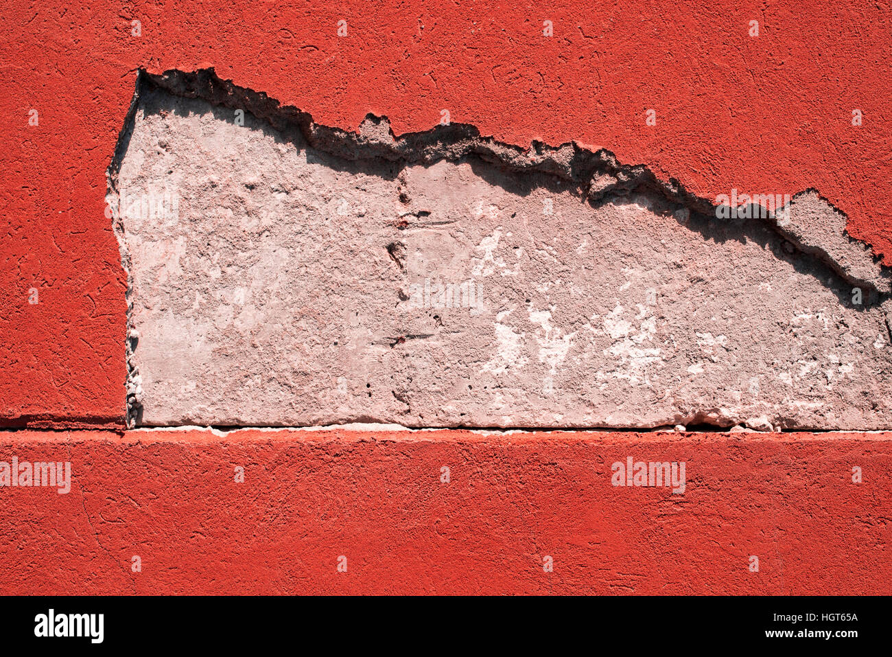 Cracked cement wall texture close-up for design or as background - Stock Image