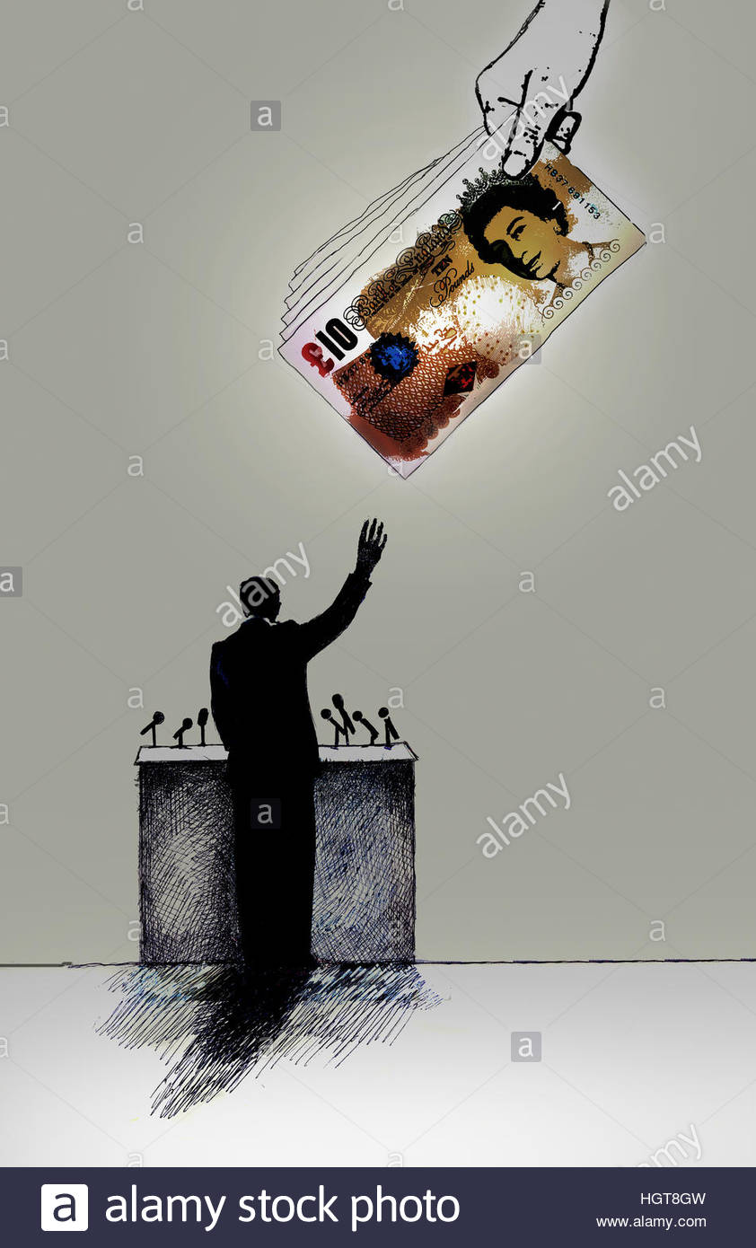 Hand giving politician pile of ten pound notes - Stock Image