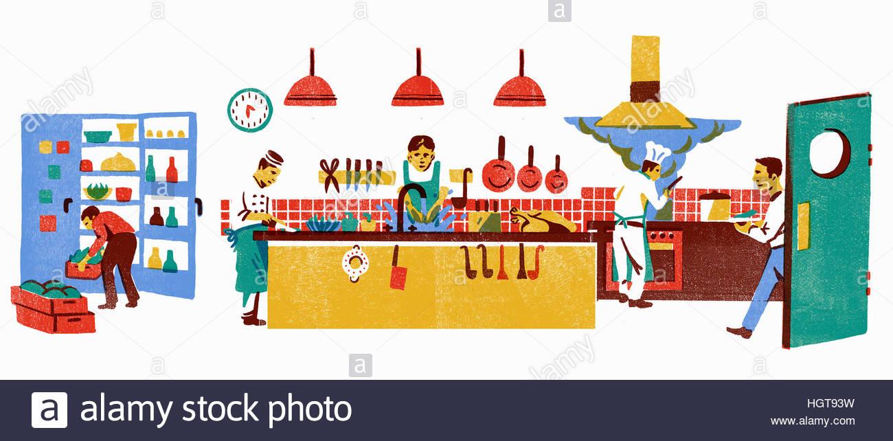 Chefs working in busy restaurant kitchen - Stock Image