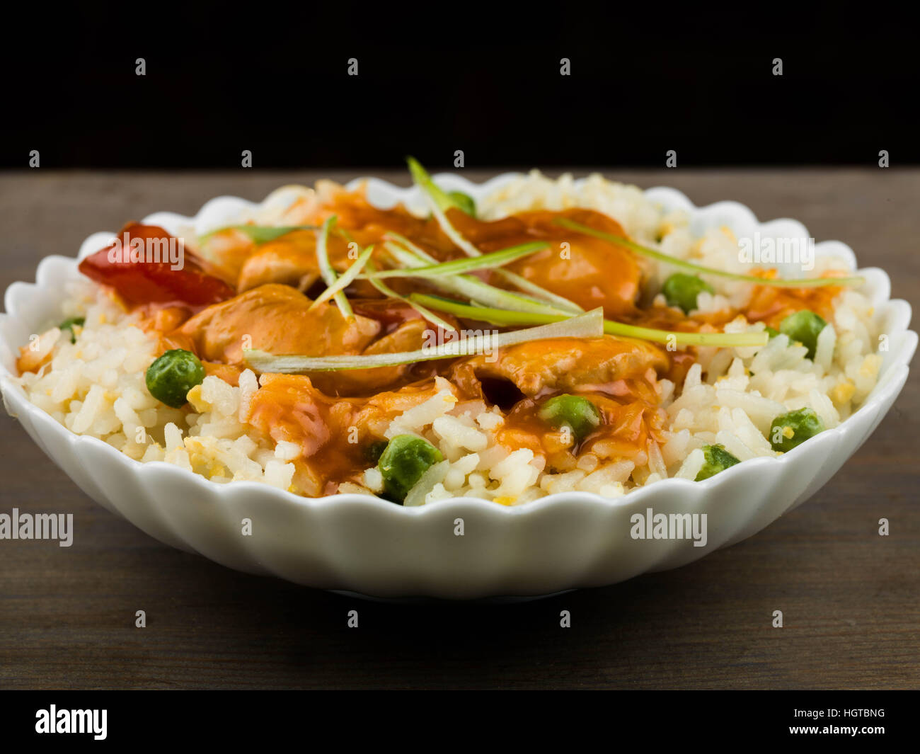 Chinese Sweet and Sour Chicken With Egg Fried Rice Meal - Stock Image