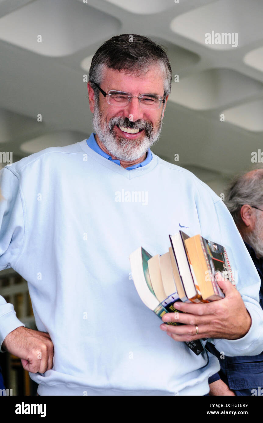 Gerry Adams laughs as he buys books in a book sale in Belfast. Stock Photo