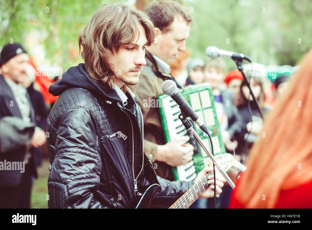 singer at the microphone in the street - Stock Image