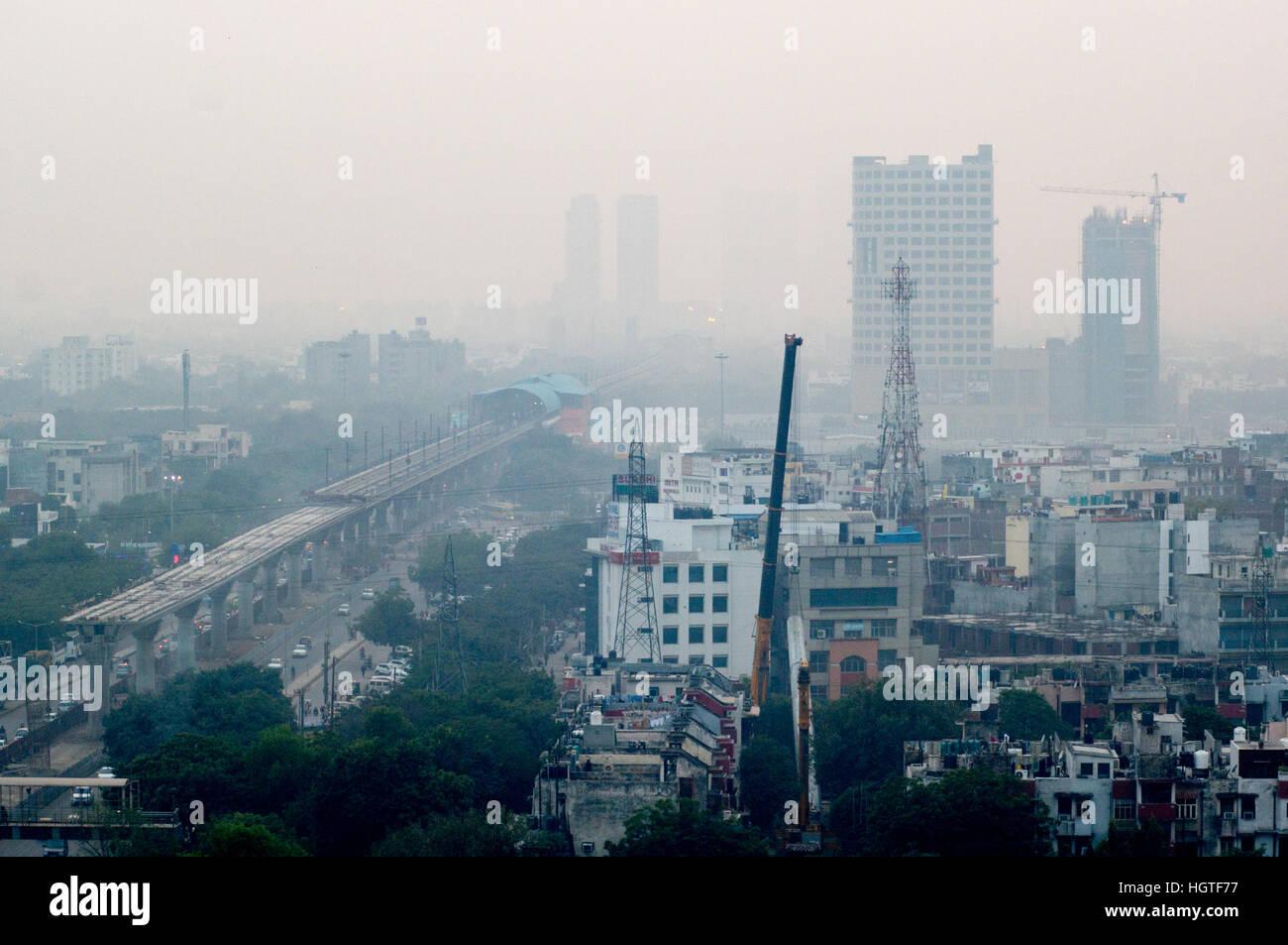 Pollution in Noida Delhi against the cityscape - Stock Image