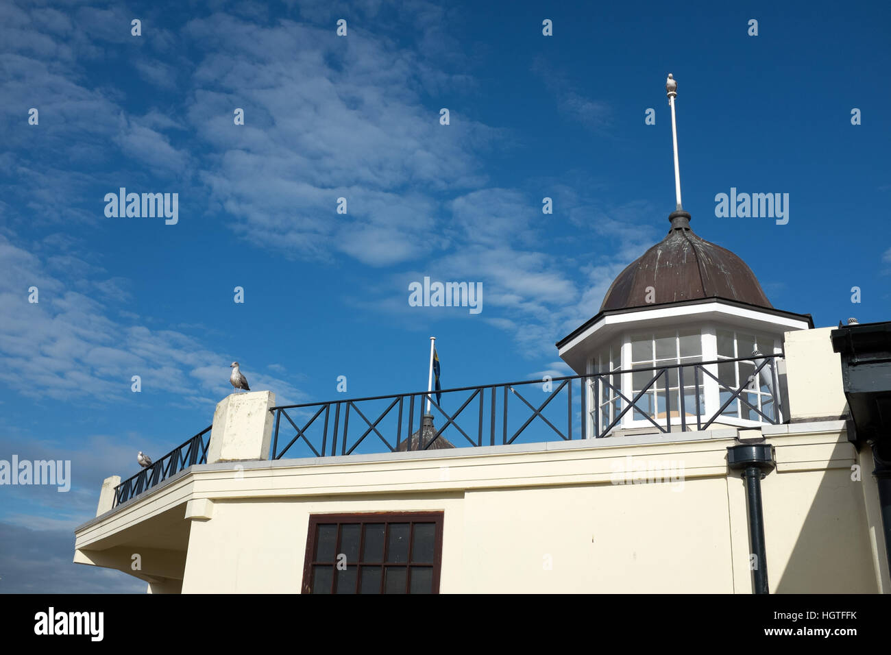 Herne Bay Central Bandstand with bright blue sky and Seagulls - Stock Image