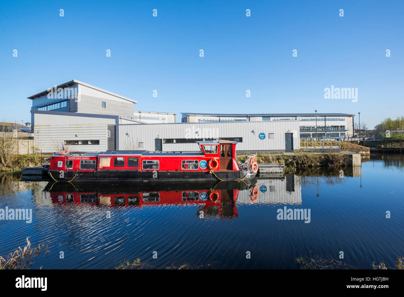 Longboat barge on Forth & Clyde canal at Kirkintilloch Marina - Stock Image