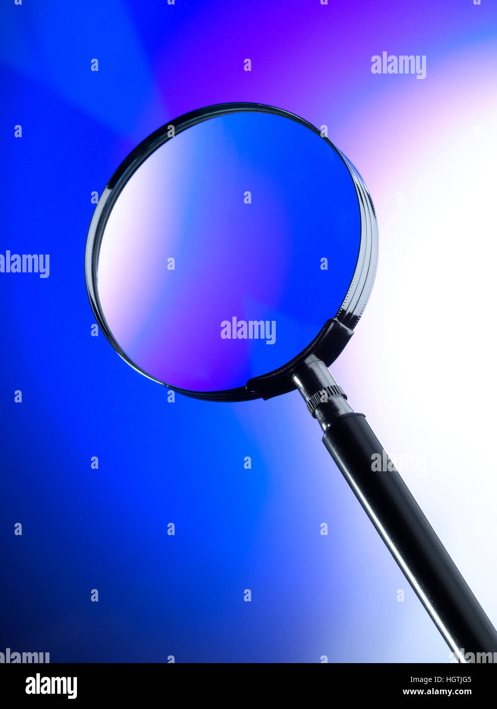 Magnifying Glass with Blue background - Stock Image