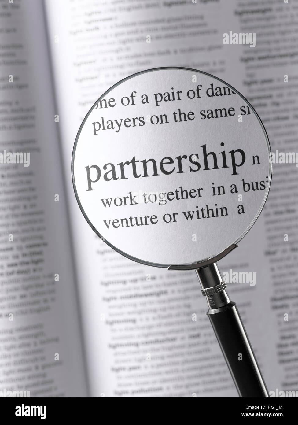 Magnifying Glass Highlighting Partnership - Stock Image