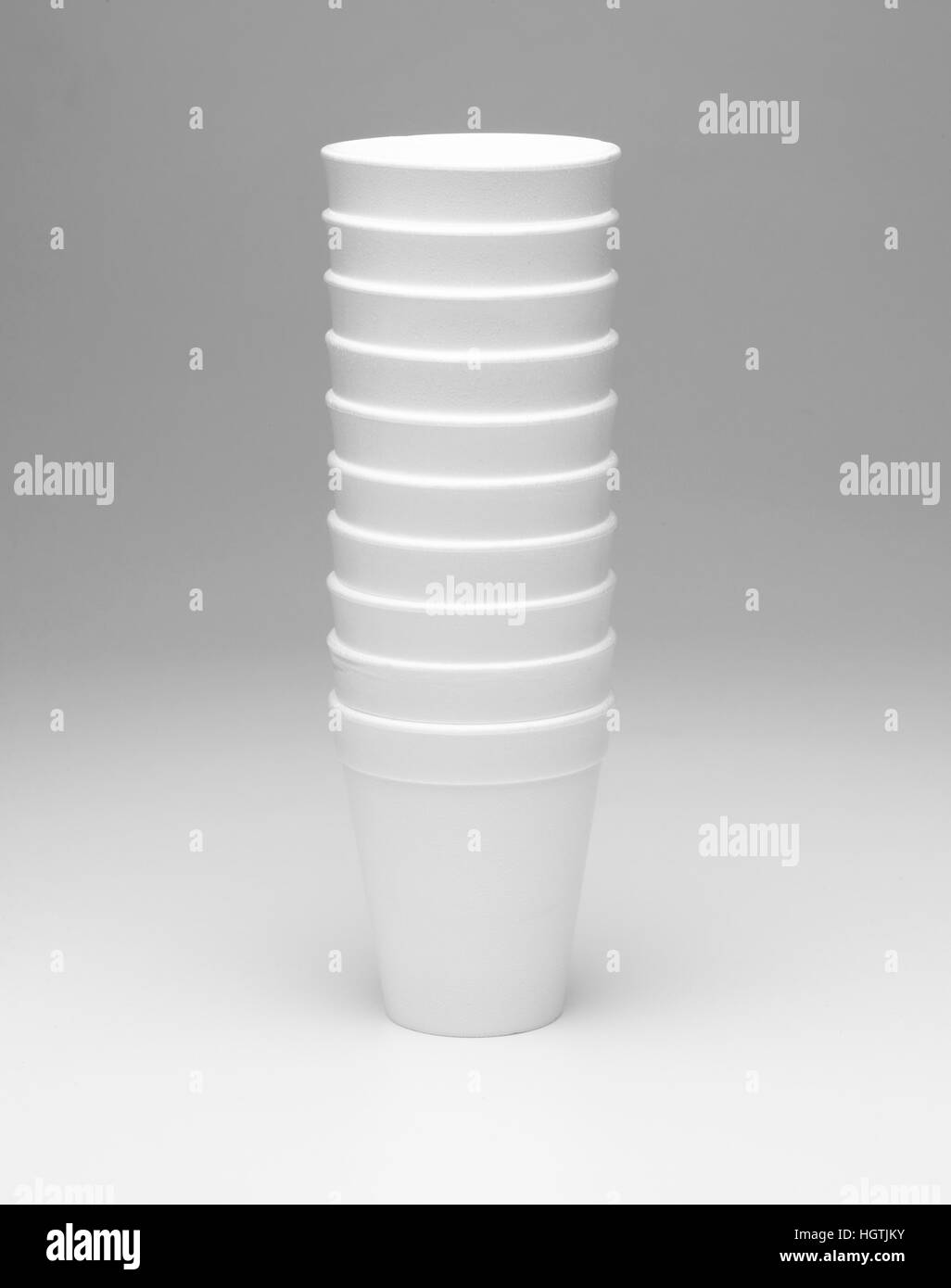 Styrofoam cup on a graduating neutral background - Stock Image