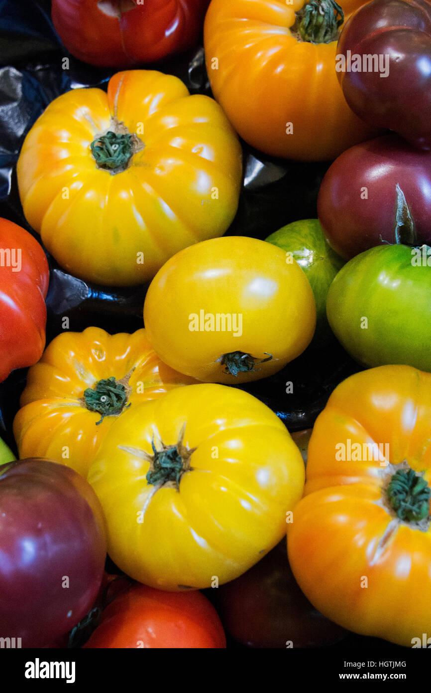 Heirloom Tomatoes on display in greengrocers in New York. - Stock Image