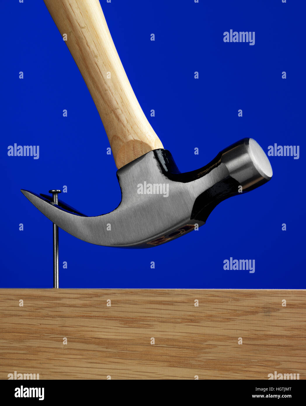 Hammer with a blue background - Stock Image