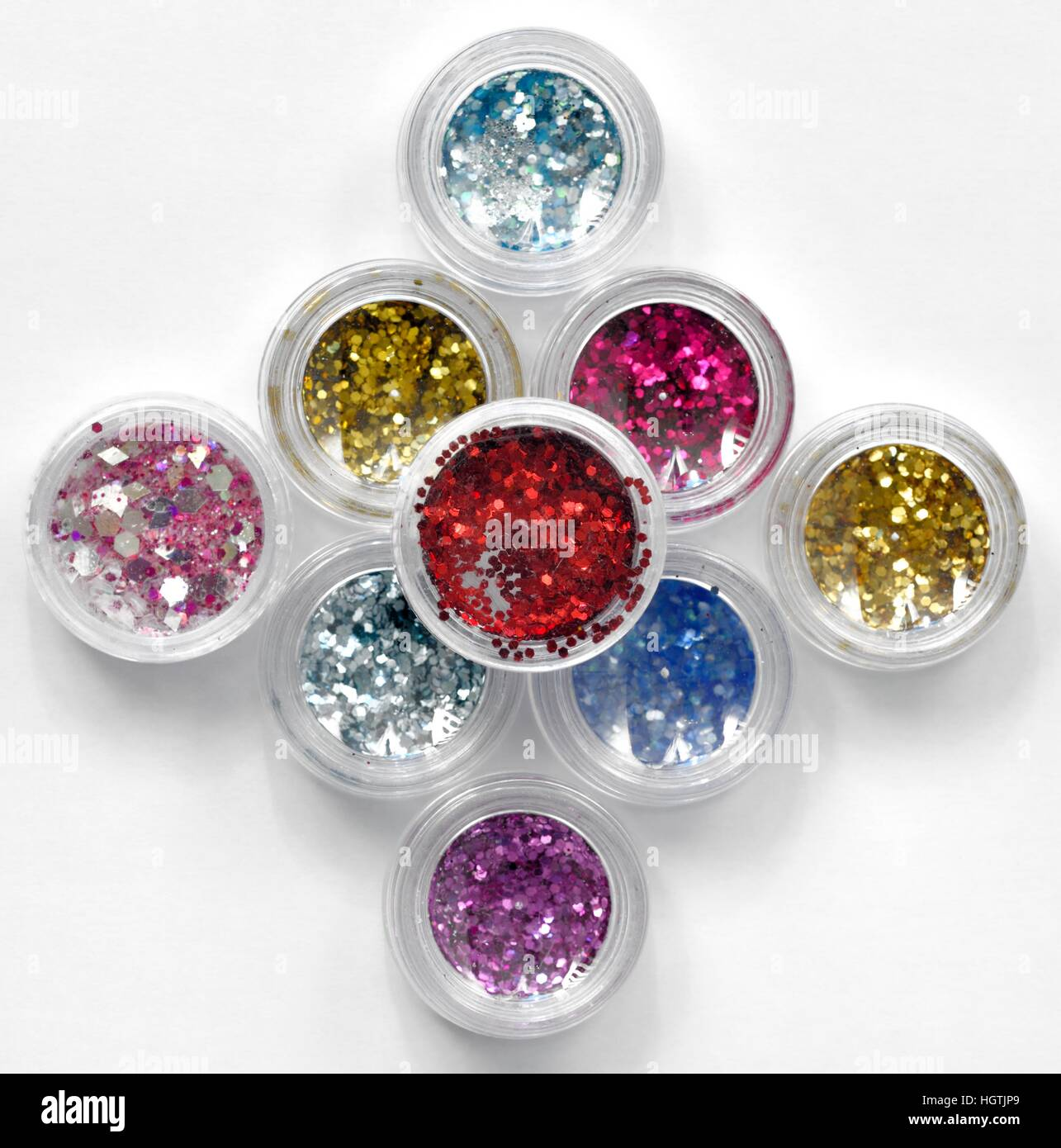 Small plastic pots of nail glitter - Stock Image