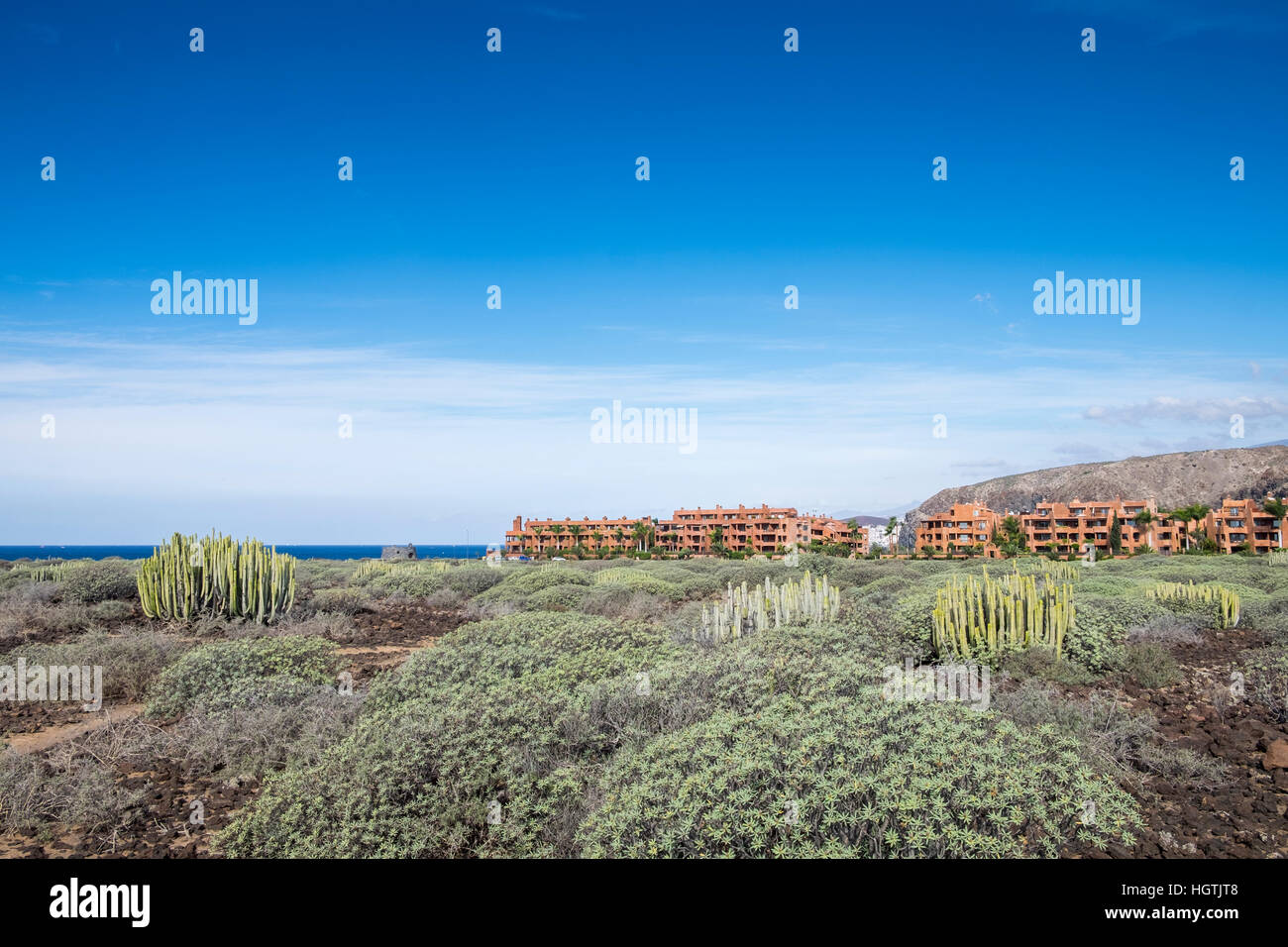 El Palm Mar urbanisation at the base of Guaza mountain next to the coast in Tenerife, Canary Islands, Spain - Stock Image