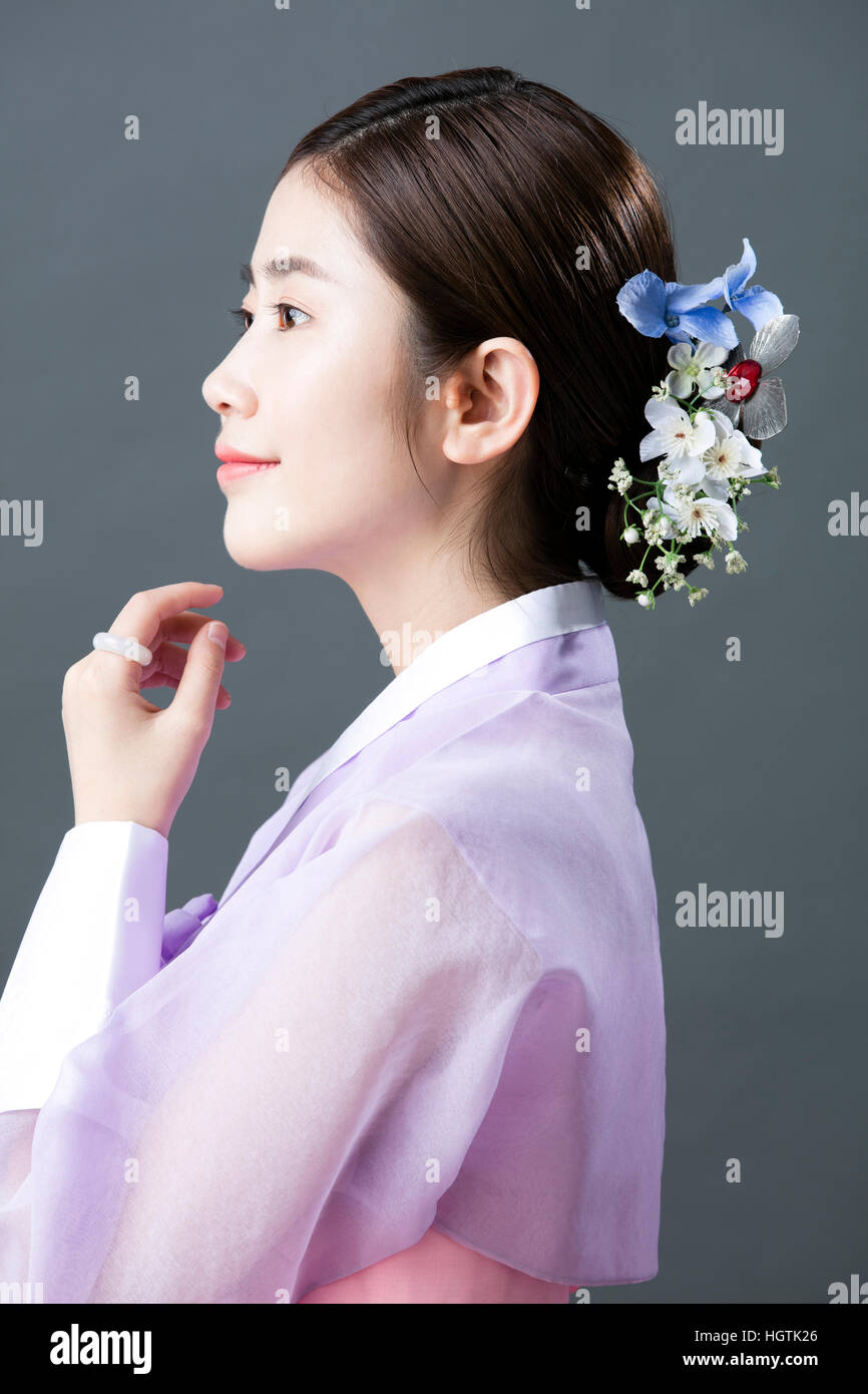Side View Portrait Of Young Woman In Traditional Korean Clothes