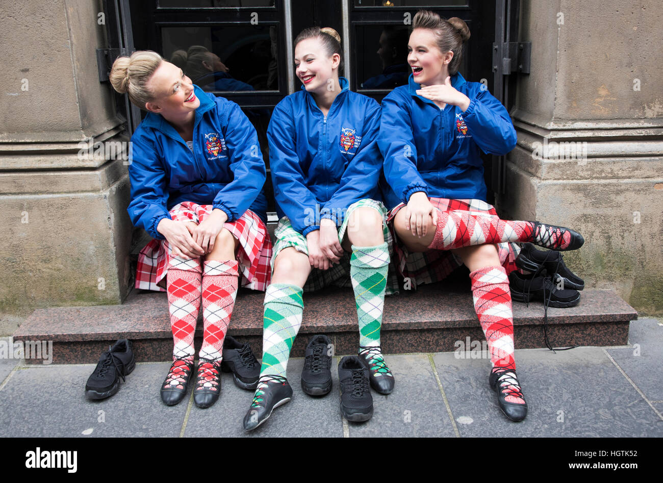 Scottish Highland Dancers taking a rest from performing at the Edinburgh Military Tattoo . Stock Photo