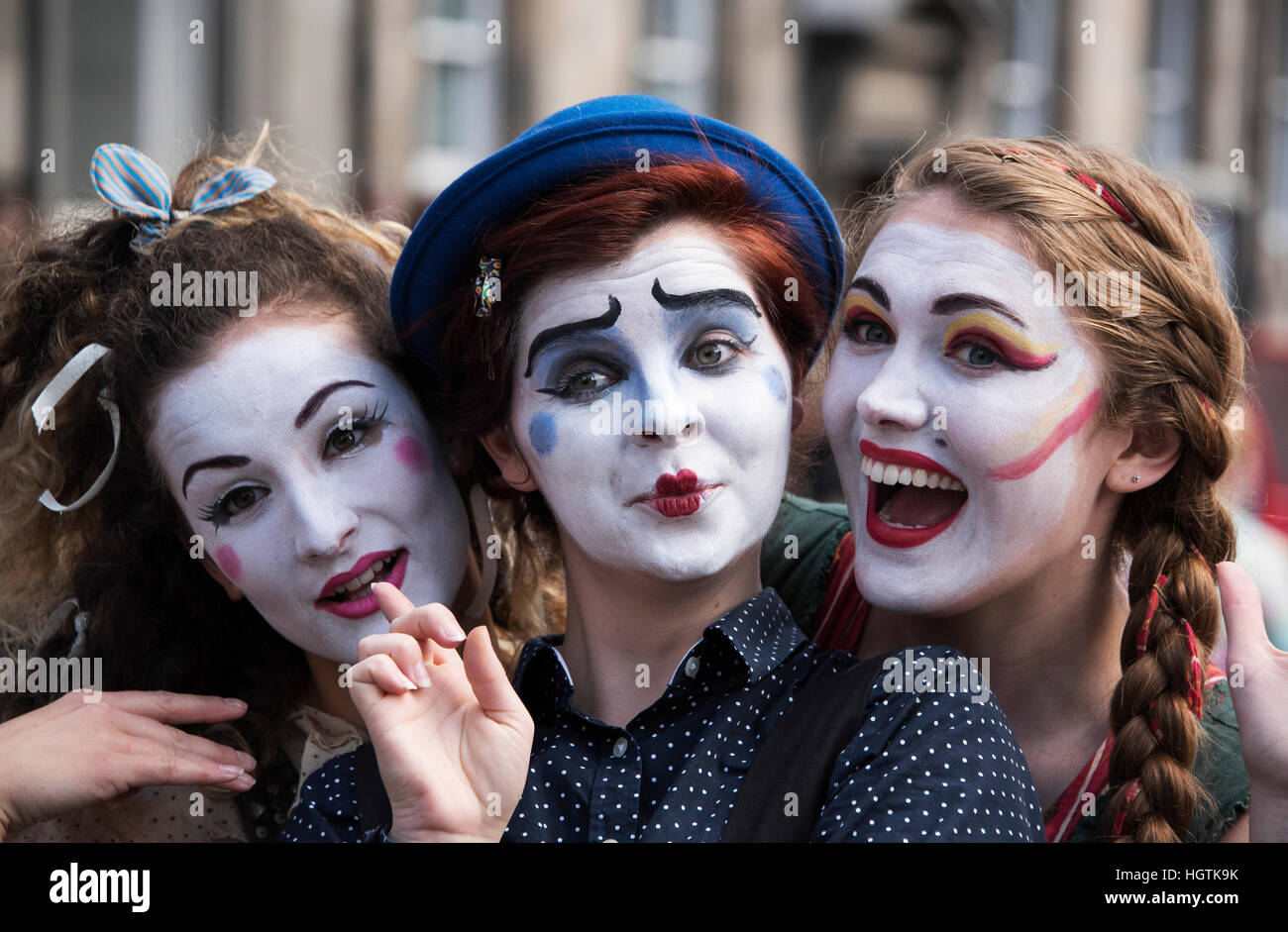 Edinburgh's Fringe Festival performers on the Royal Mile promoting their show. - Stock Image