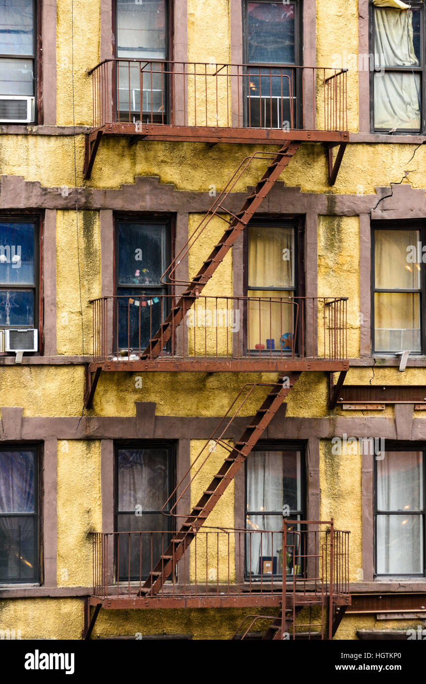 Fire escape ladders at the back of a run down apartment block as seen from the High Line in New York Stock Photo