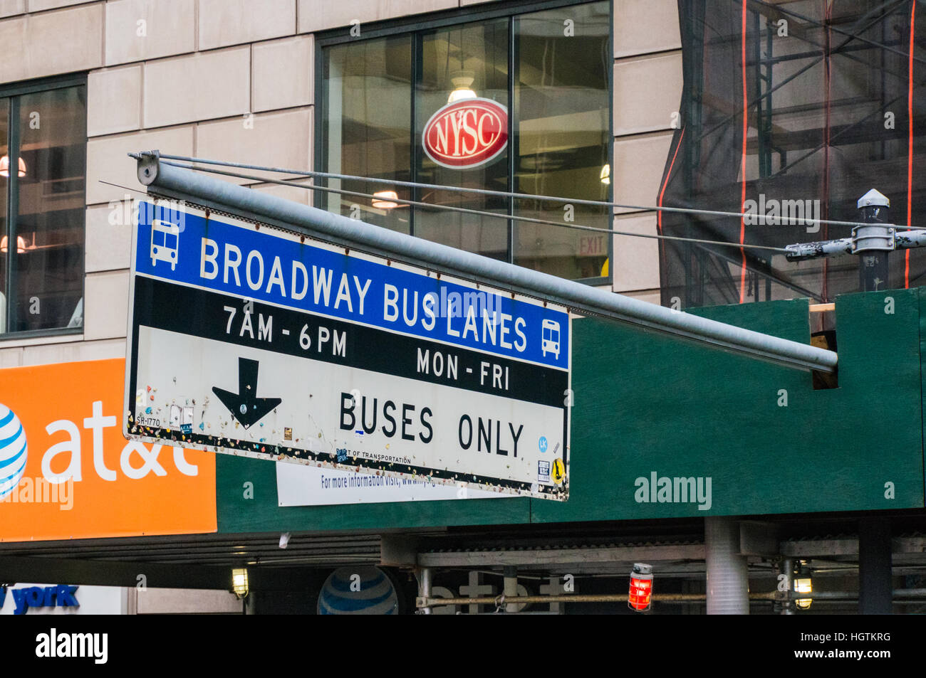 Chewing gum on the bottom of a Broadway Bus Lanes traffic sign in New York Stock Photo