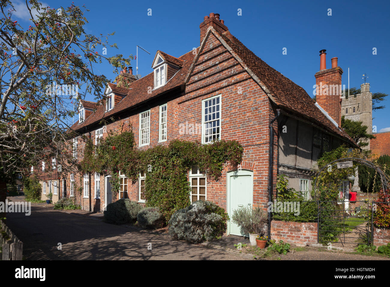 A row of cottages and the church of St Mary the Virgin in the Chiltern Hills village of Hambleden, Hambleden Valley, - Stock Image