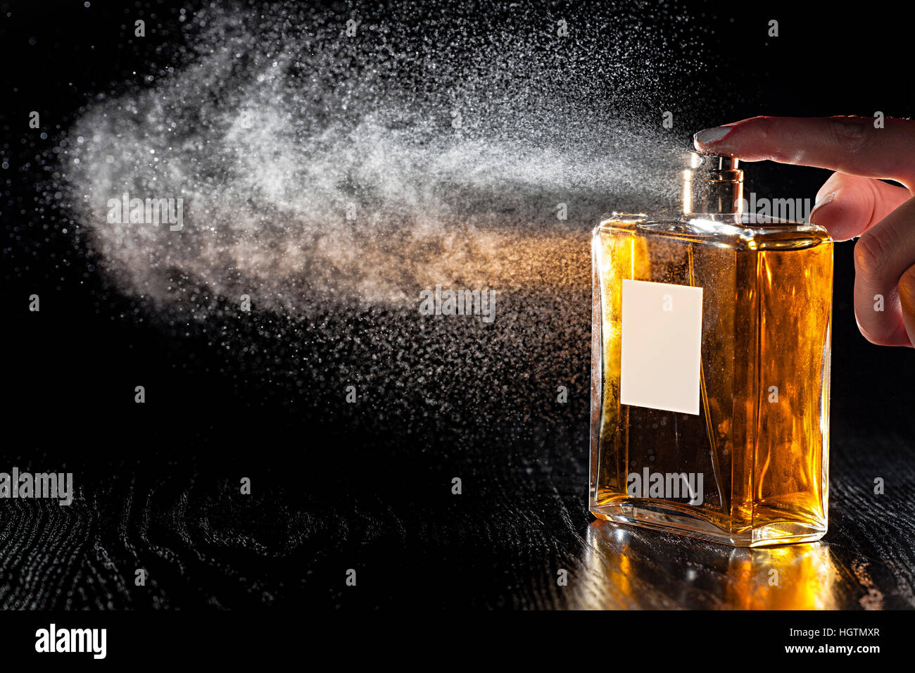 perfume with black background - Stock Image