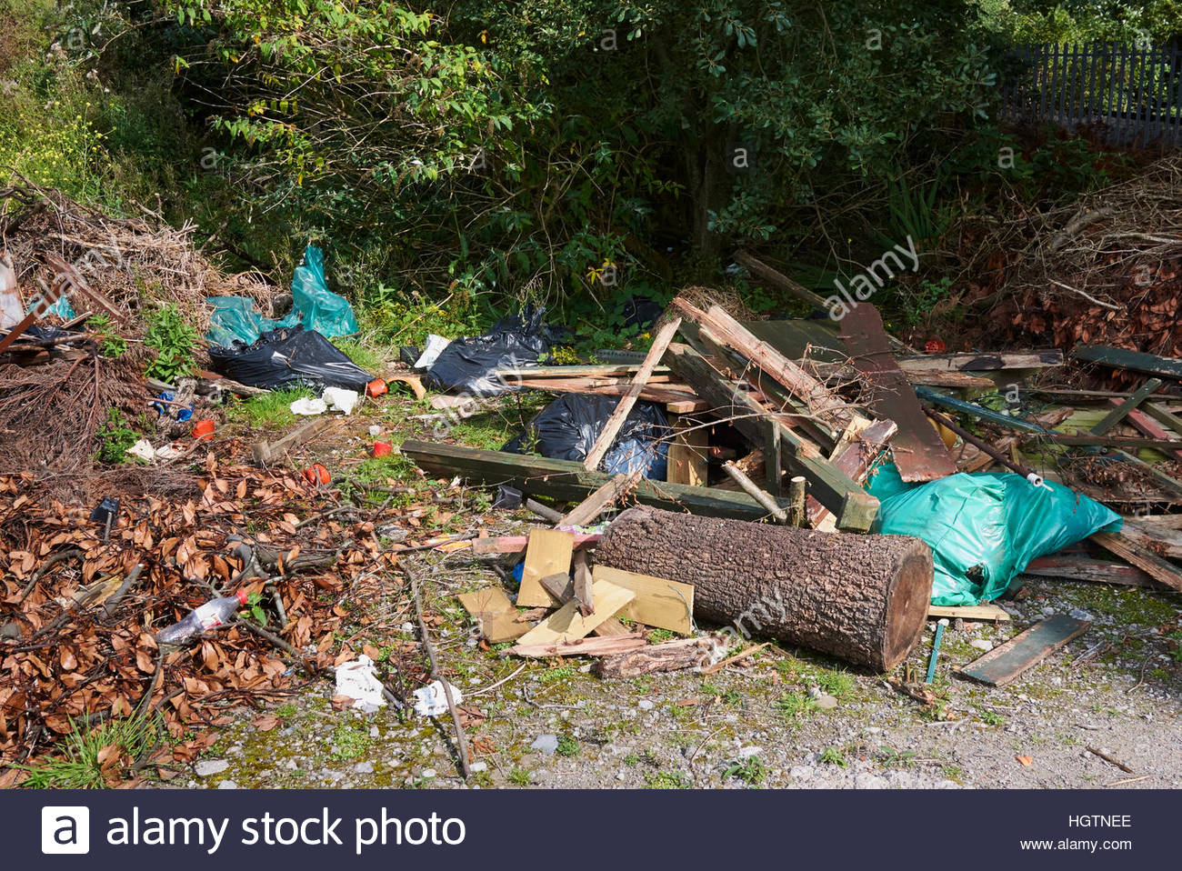 A piled of rubbish flytipped on waste ground in the countryside - Stock Image
