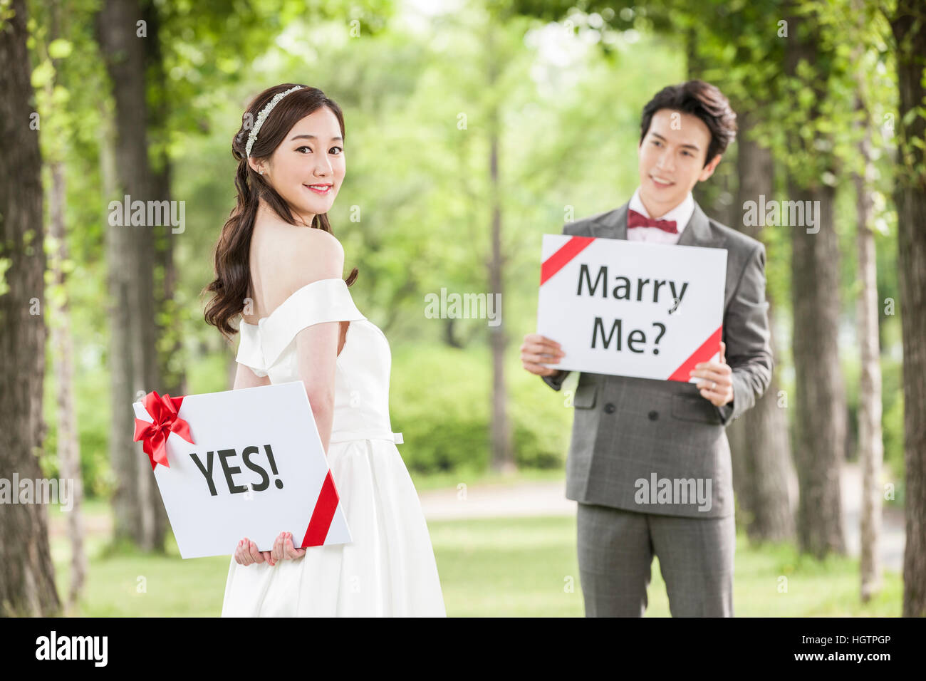 Young Romantic Wedding Couple Posing With English Messages Outdoors Stock Photo Alamy