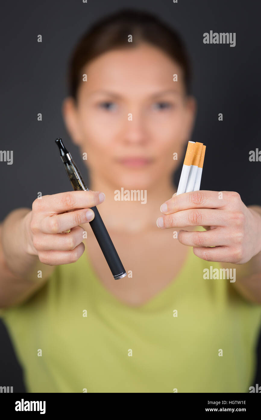 choosing between the classic cigarette or electronic cigarette - Stock Image