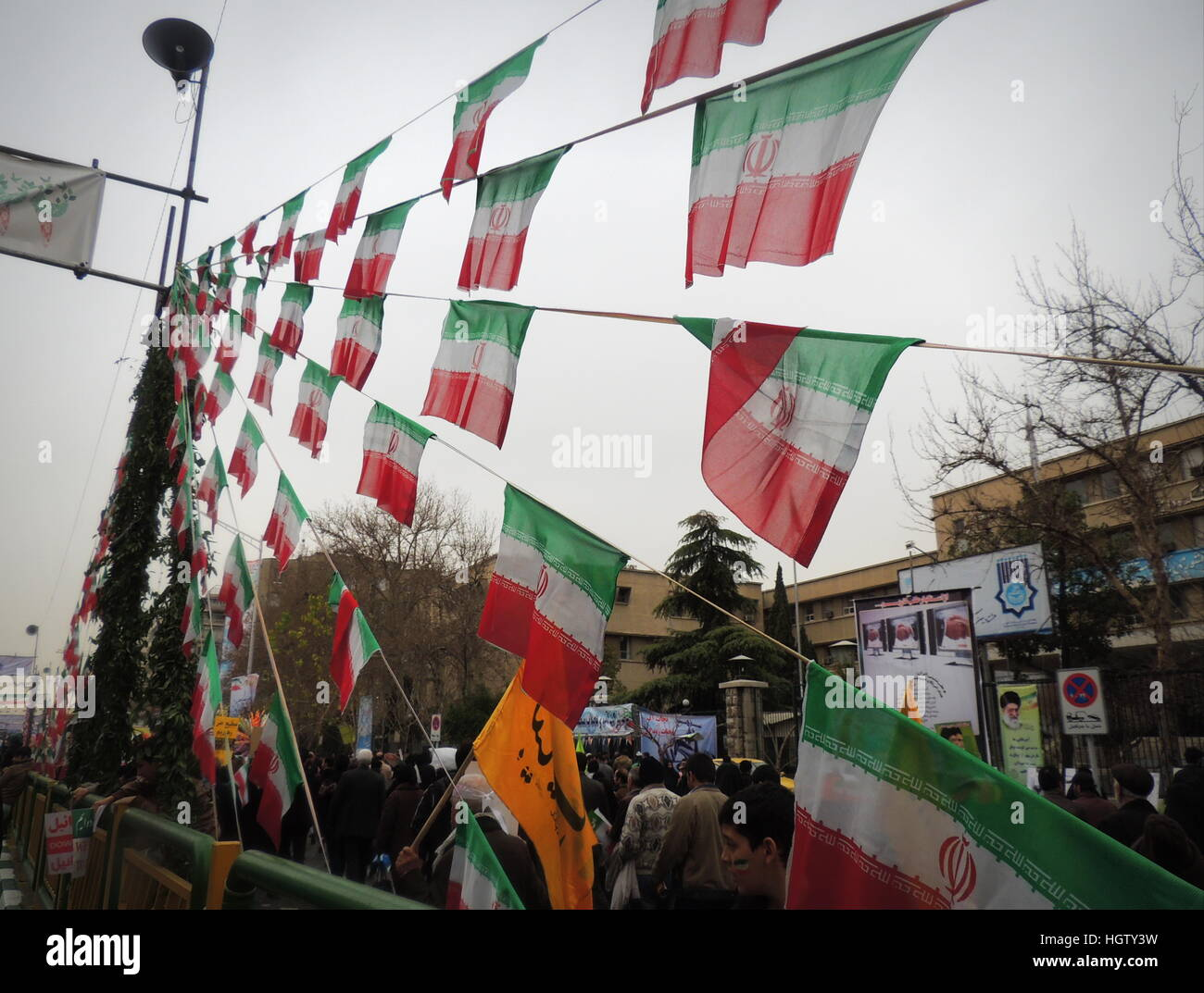 Iranian flags at Islamic Revolution anniversary rally, national day of Iran in Tehran - Stock Image