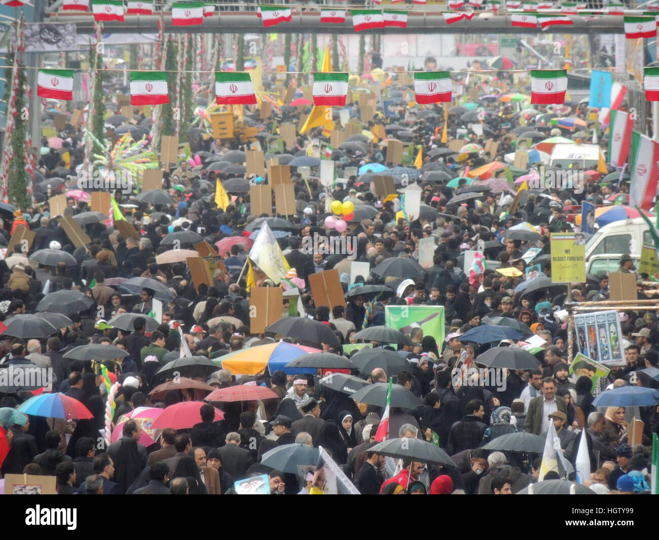 Iranian people crowds for Islamic Revolution anniversary rally, national day of Iran in Tehran - Stock Image