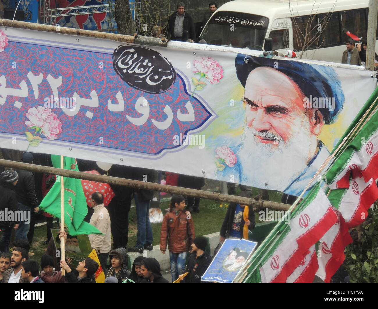 Imam Khomeini banner over Iranian people march for the Islamic Revolution anniversary rally, national day of Iran - Stock Image