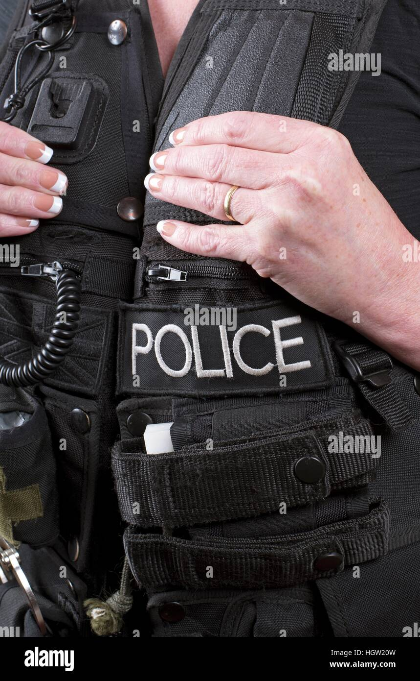 Married police officer wearing a tactical vest Stock Photo