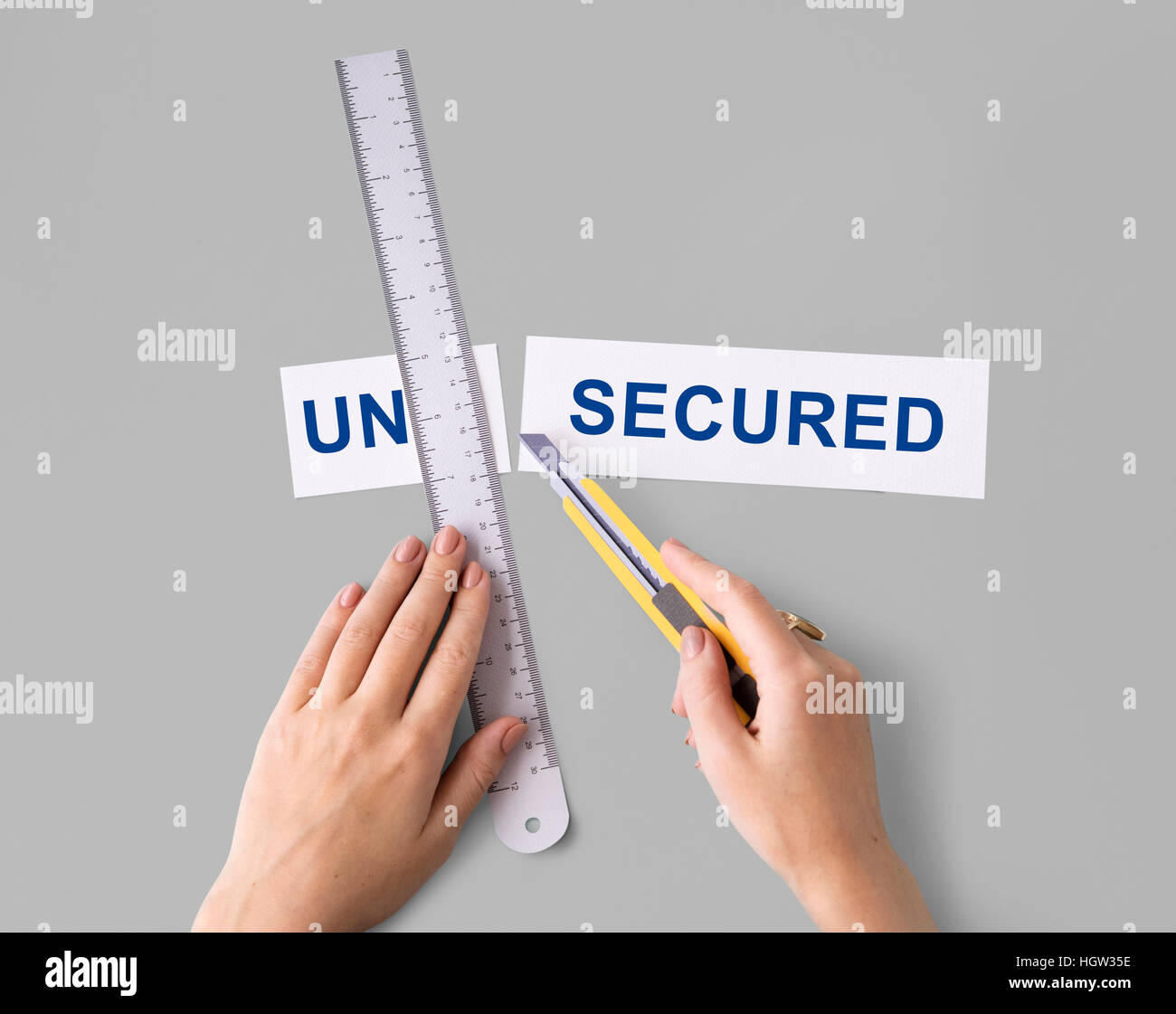 Unsecured Insecure Hand Cut Word Split Concept - Stock Image