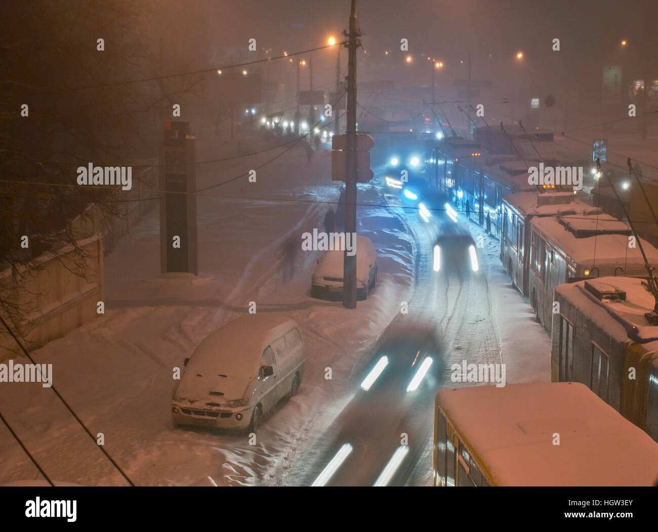a lot of trolleybuses are in traffic because of a snowy and slippery roads, kyiv, ukraine. - Stock Image