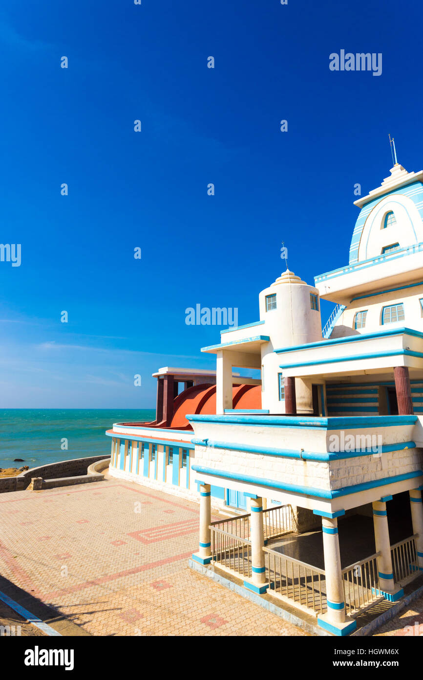Side oceanfront view of Gandhi Memorial Mandapam on the Indian southernmost tip city of Kanyakumari on a sunny day - Stock Image