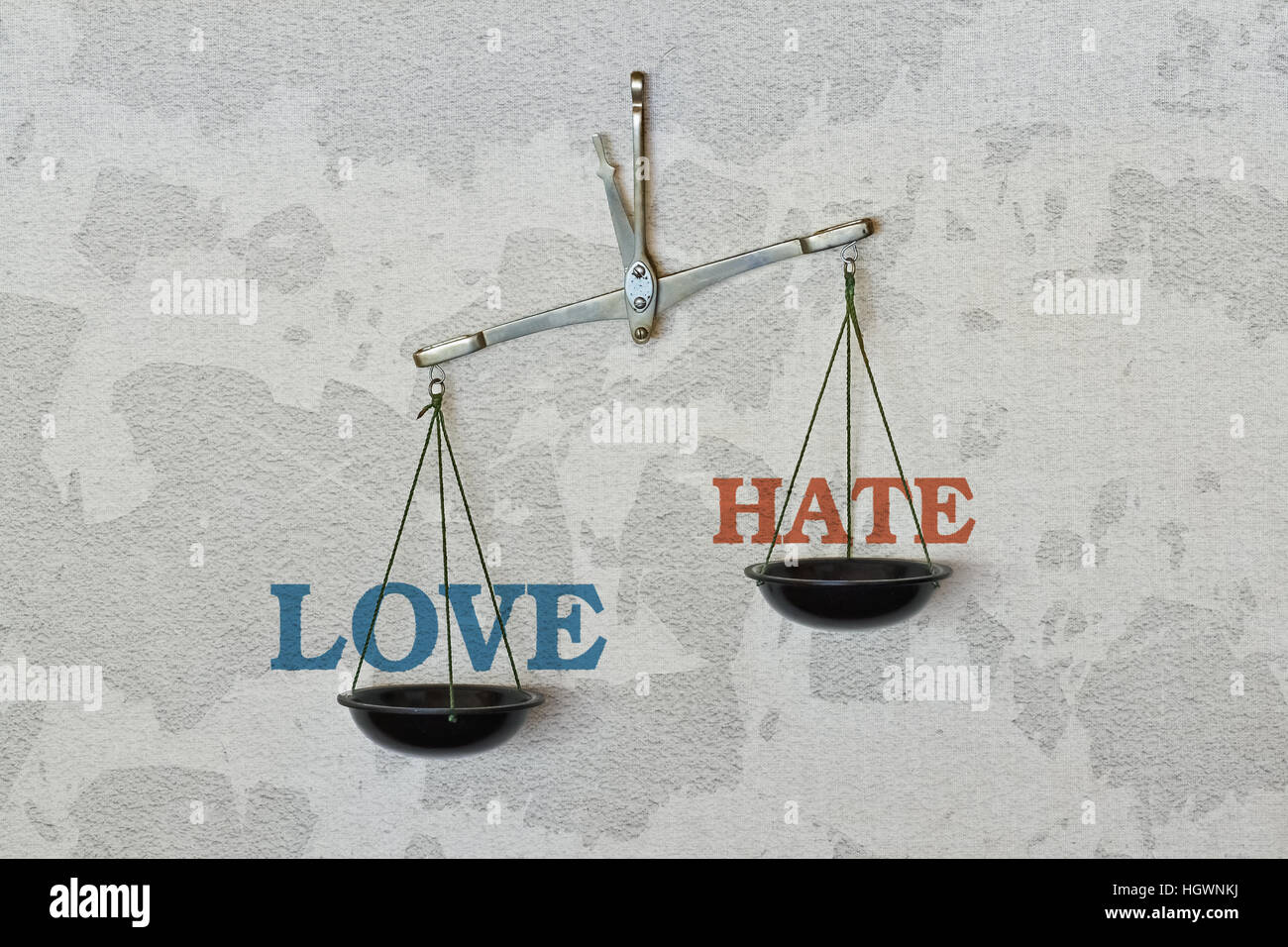 Words Love and Hate and a balance on bright background - Stock Image