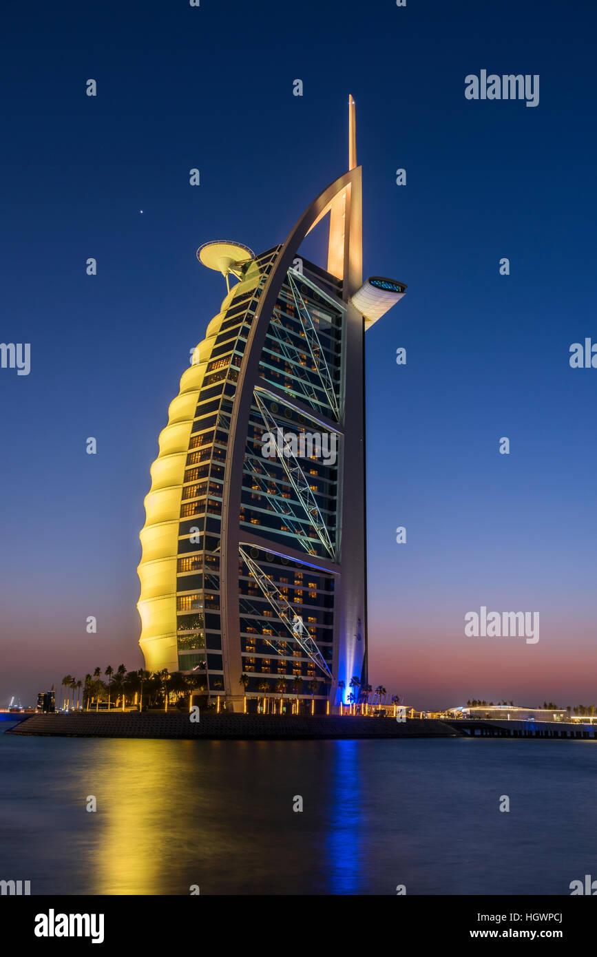 Burj Al Arab luxury hotel at twilight, Dubai, United Arab Emirates - Stock Image
