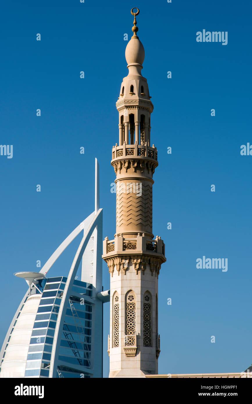 Minaret with Burj al Arab behind, Dubai, United Arab Emirates - Stock Image