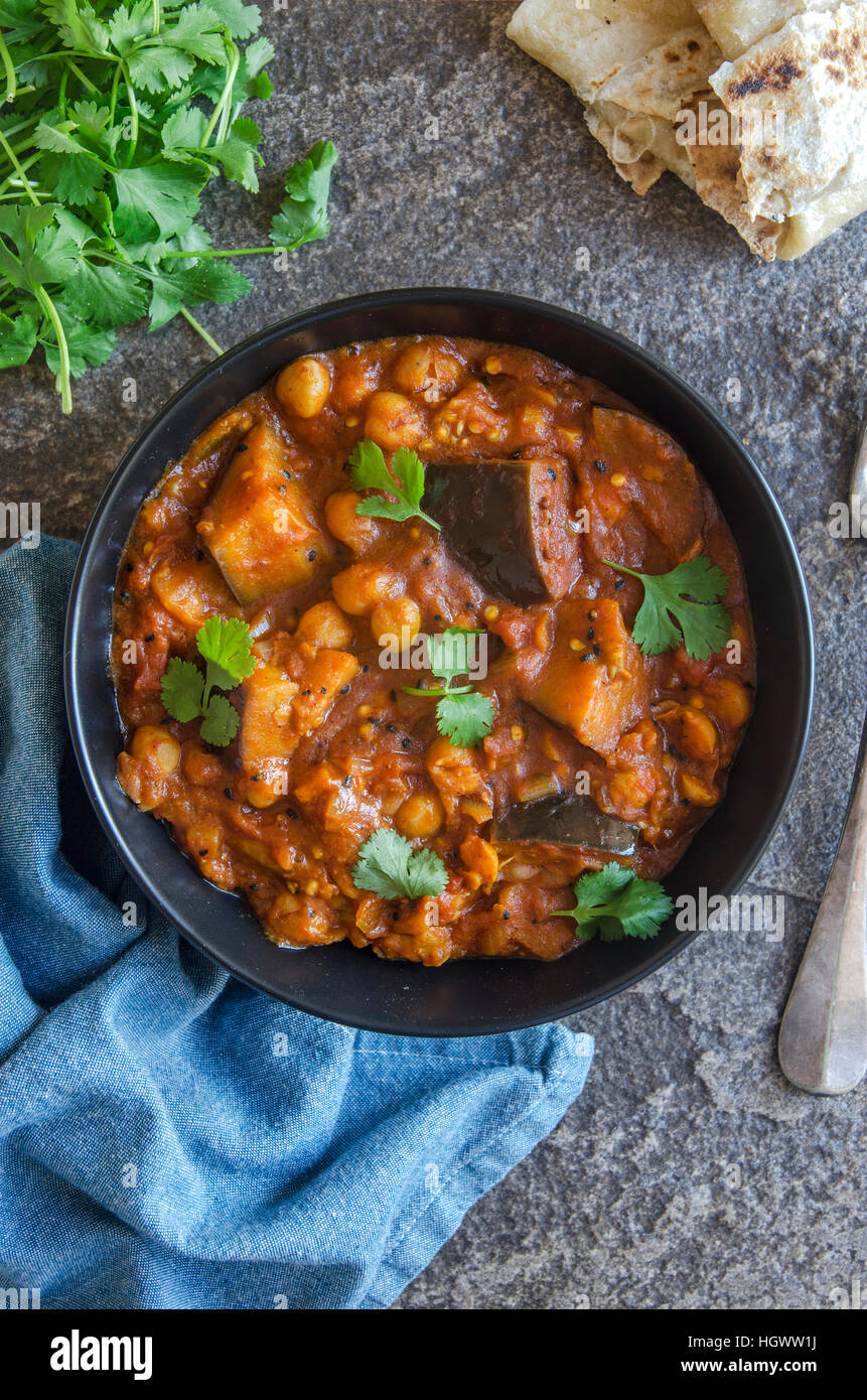Aubergine and chickpea Madras topped with coriander - Stock Image