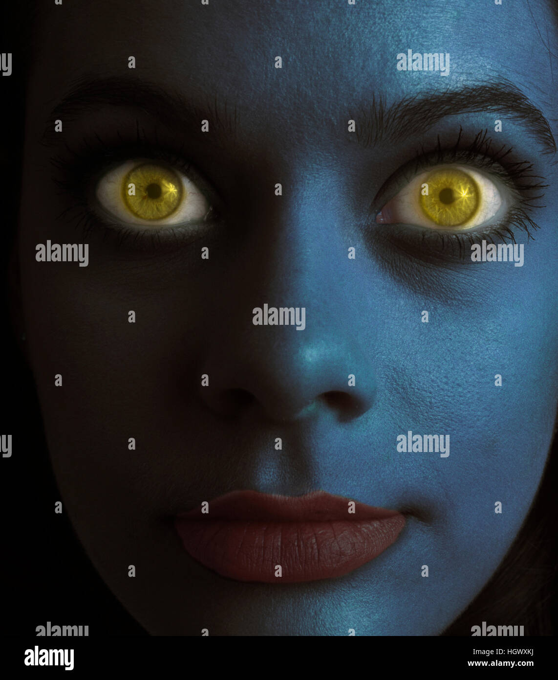 Blue woman with big yellow eyes - Stock Image