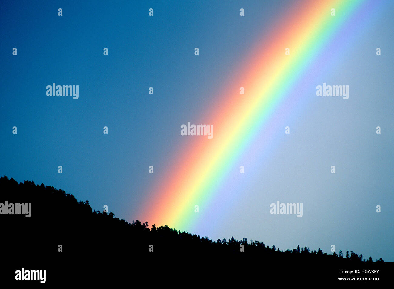 Rainbow in Rocky Mountain foothills west of Boulder, CO - Stock Image