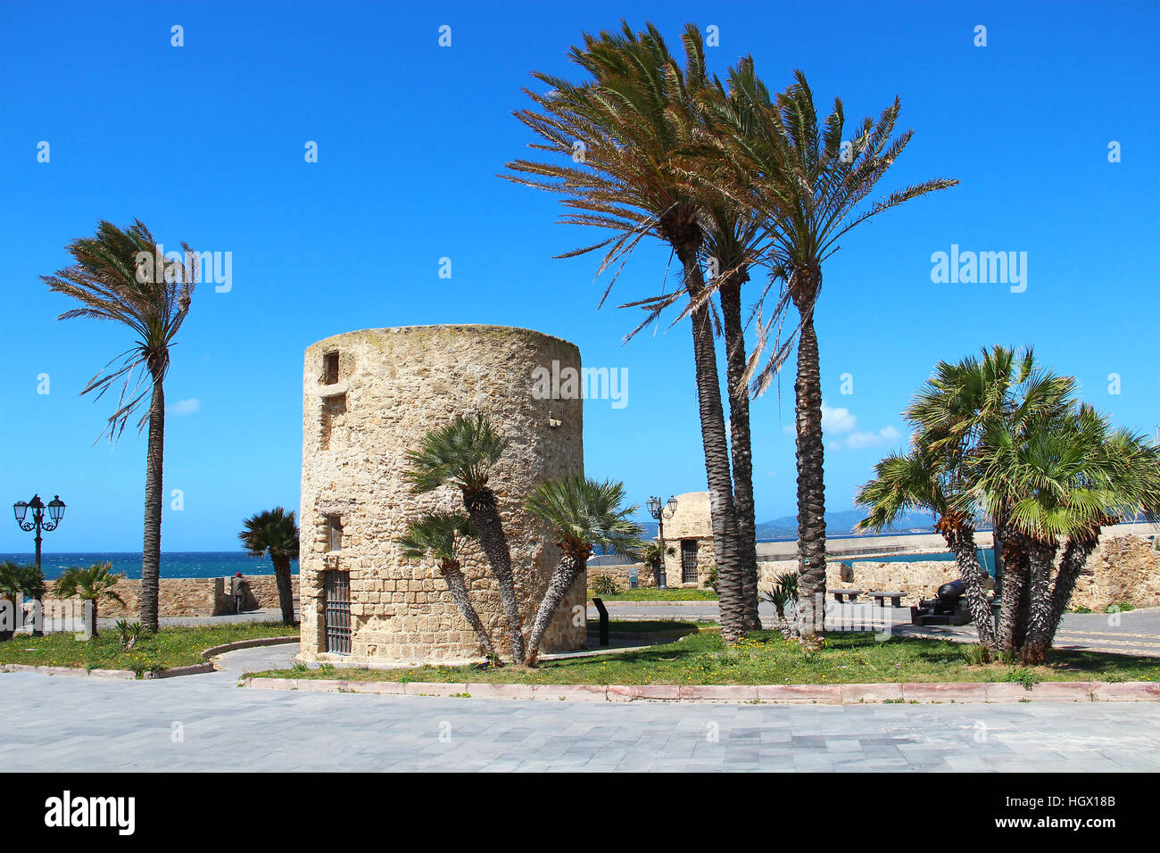 Fortification tower and walls in Alghero old town, Sardinia, Italy - Stock Image