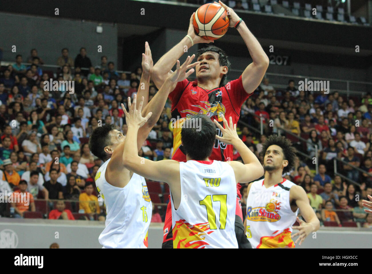 Junemar Fajardo of San Miguel overpowers three defenders from Rain or Shine to convert a close range jumpshot. (Photo - Stock Image