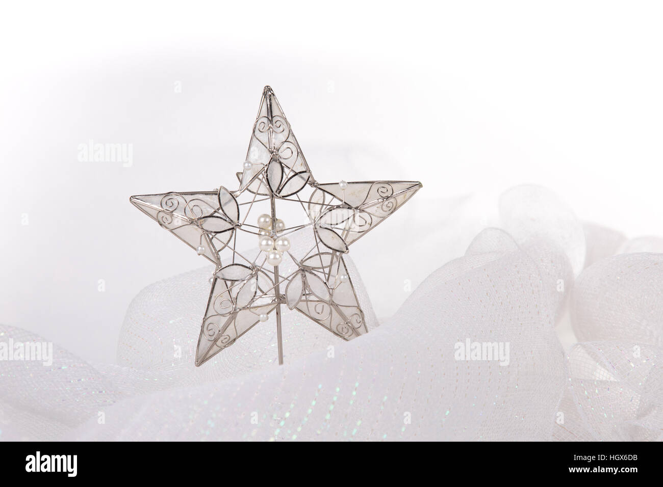 Star Ornament in white snowy cloth resembling snow.display - Stock Image