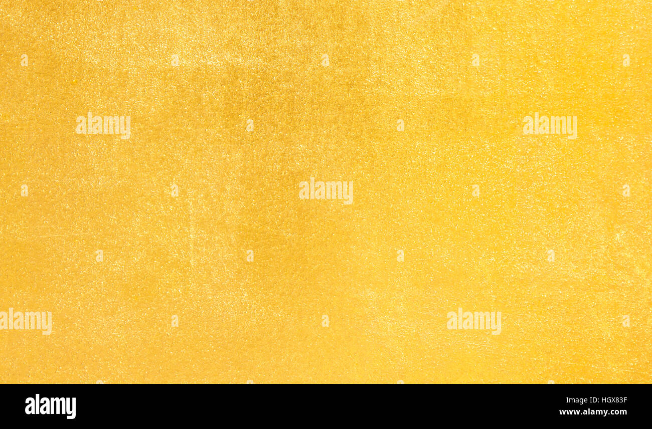 Gold Background / gold polished metal, steel texture. - Stock Image