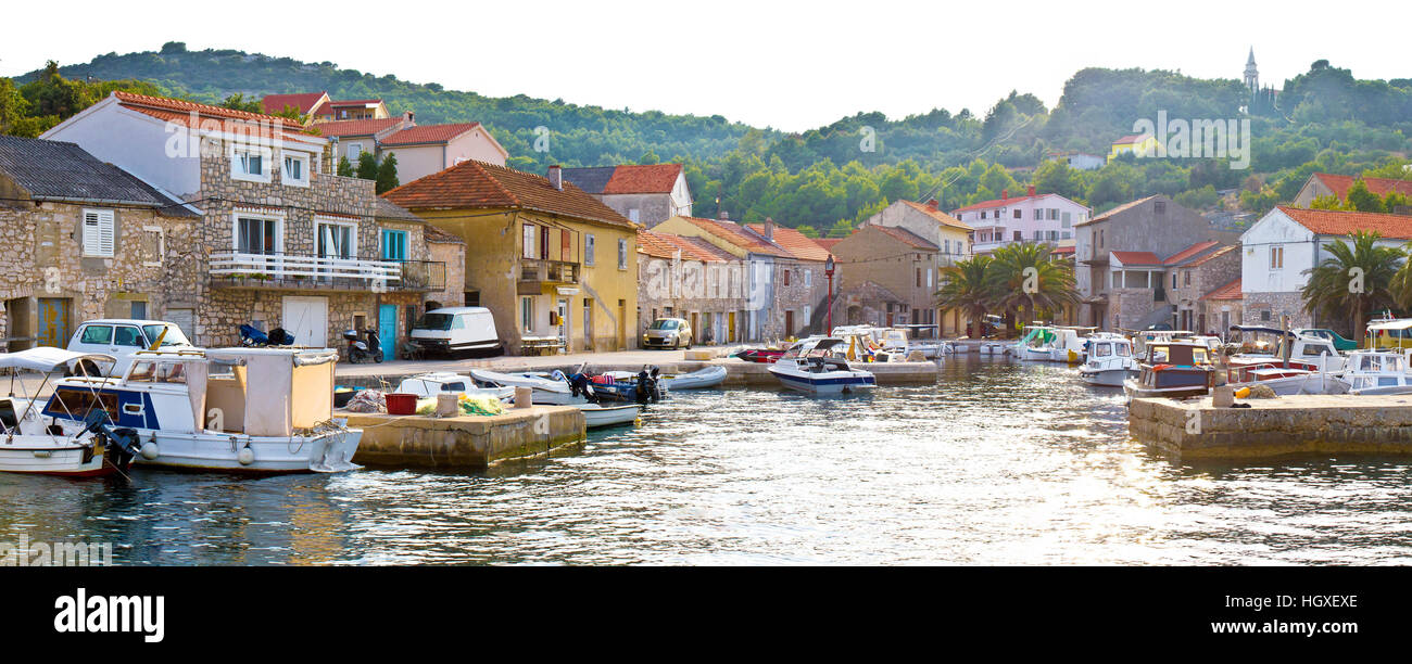Island of Iz pictoresque harbor, Dalmatia, Croatia - Stock Image