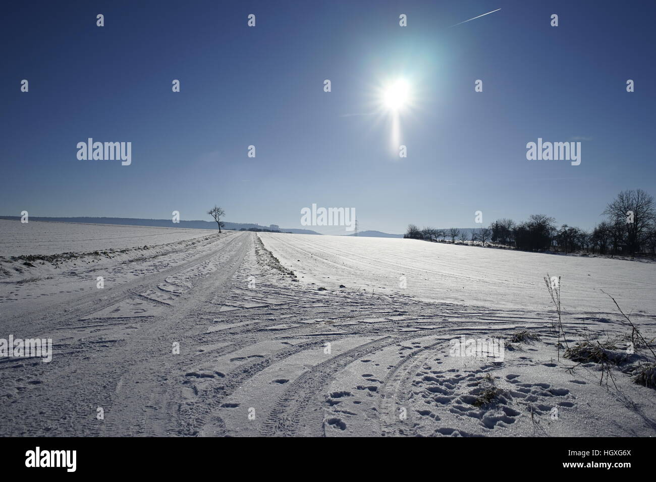 Sunny winter landscape view with blue sky - Stock Image