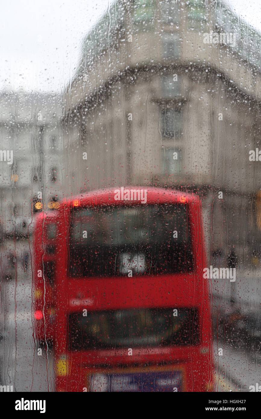 London's famous buses and its equally famous rain - Stock Image