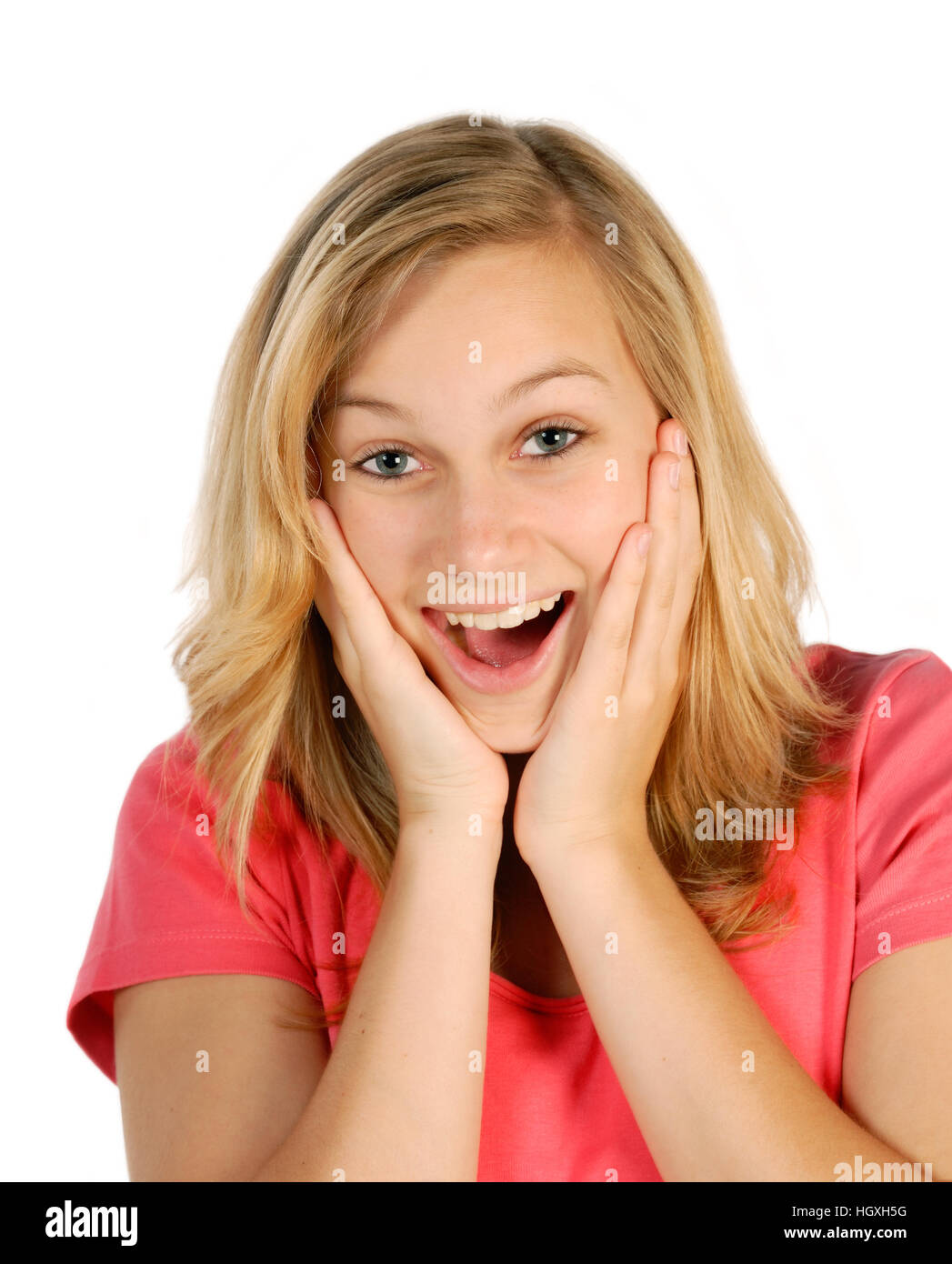 Blonde young woman is surprised and pleased - Stock Image