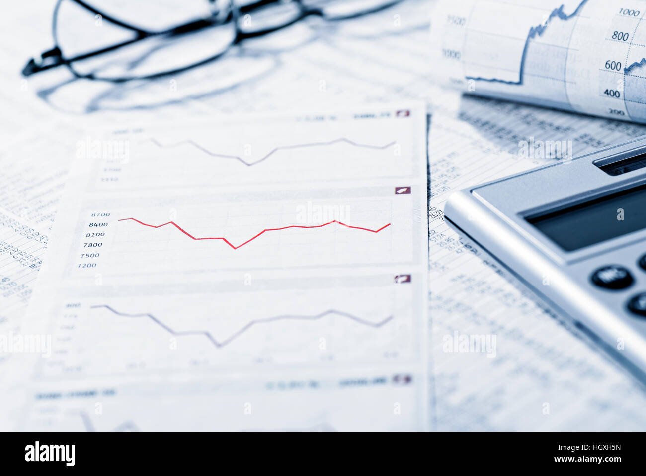 Rate tables and diagrams symbolize the volatility of the financial market. - Stock Image