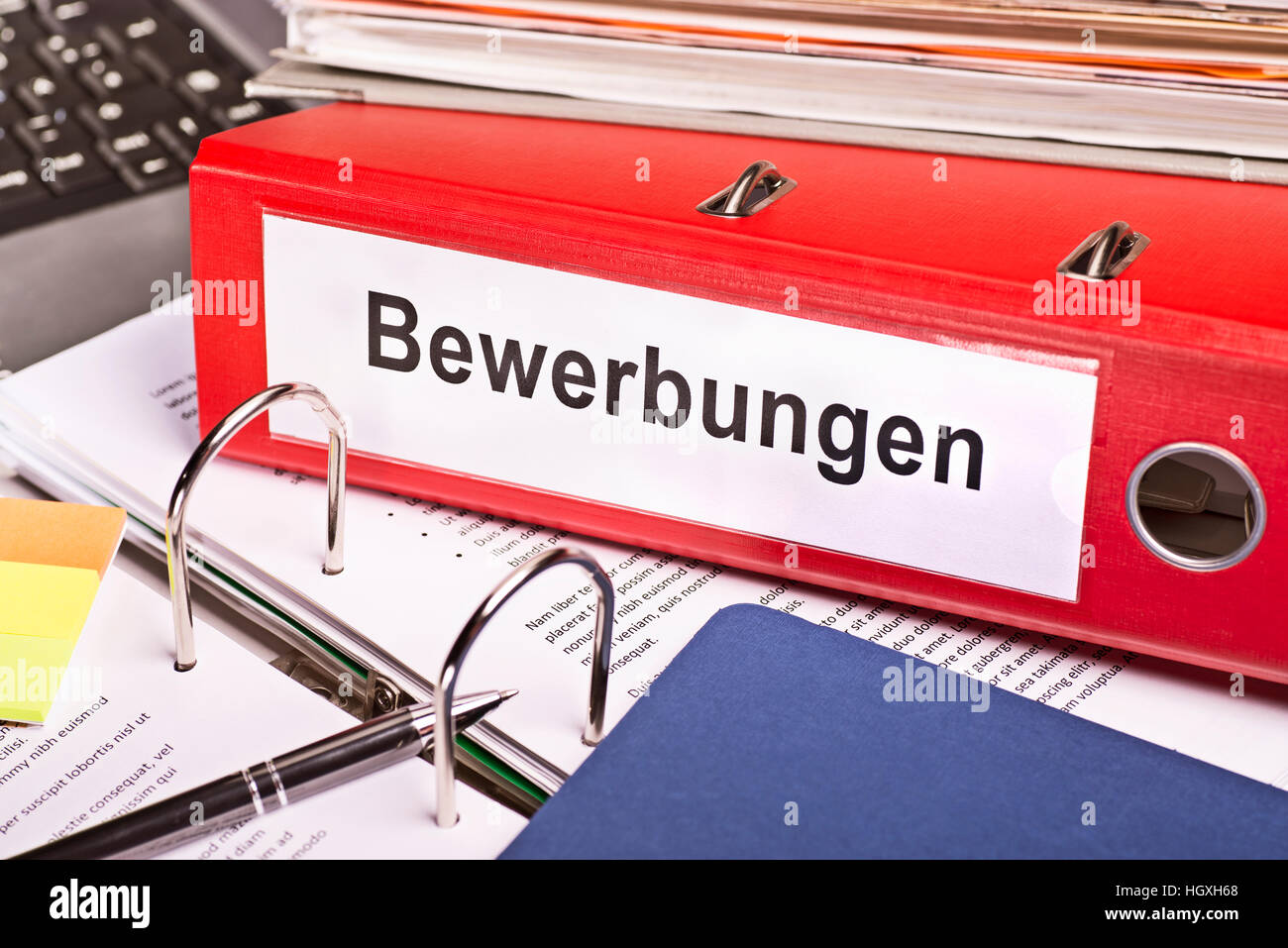 Red file folder labeled 'Bewerbungen' for Applications - Stock Image