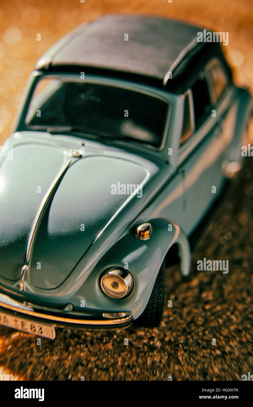 A VW Beetle convertible on sandy ground - Stock Image